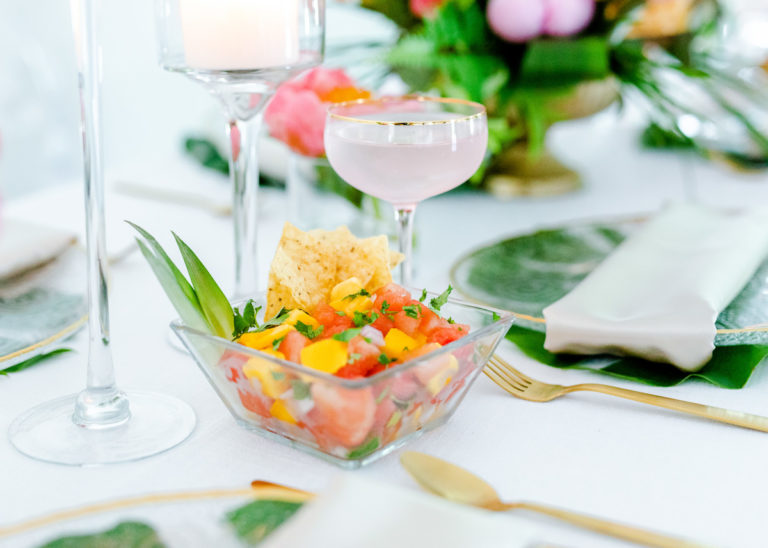 salsa and chips in glass dish