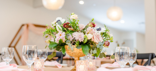 South Haven Creations wedding venue table setting with flowers