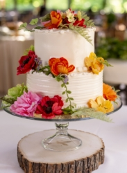 small white wedding cake with flowers