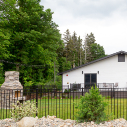 front lawn with deck and fireplace at south haven creations venue