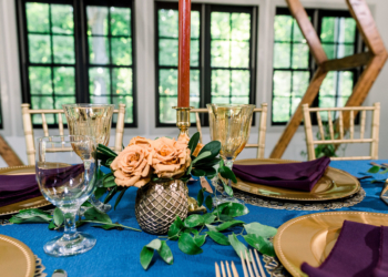 Wedding tablescape with blue and gold