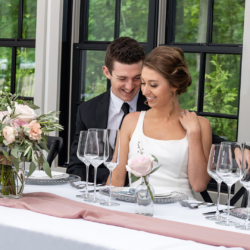 couple sitting at head table at south haven creations venue