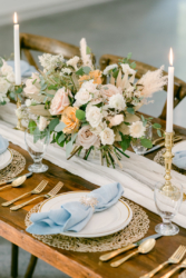 flowers on tables setting at south haven creations wedding venue