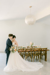 bride and groom in the event space at south haven creations wedding venue