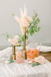 cocktail on table with flowers