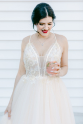 bride on deck at south haven creations wedding venue