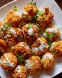 event catering mac and cheese balls on white plate