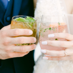 wedding couple with cocktails in hand