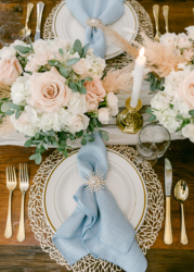 wedding tablescape with blue napkin